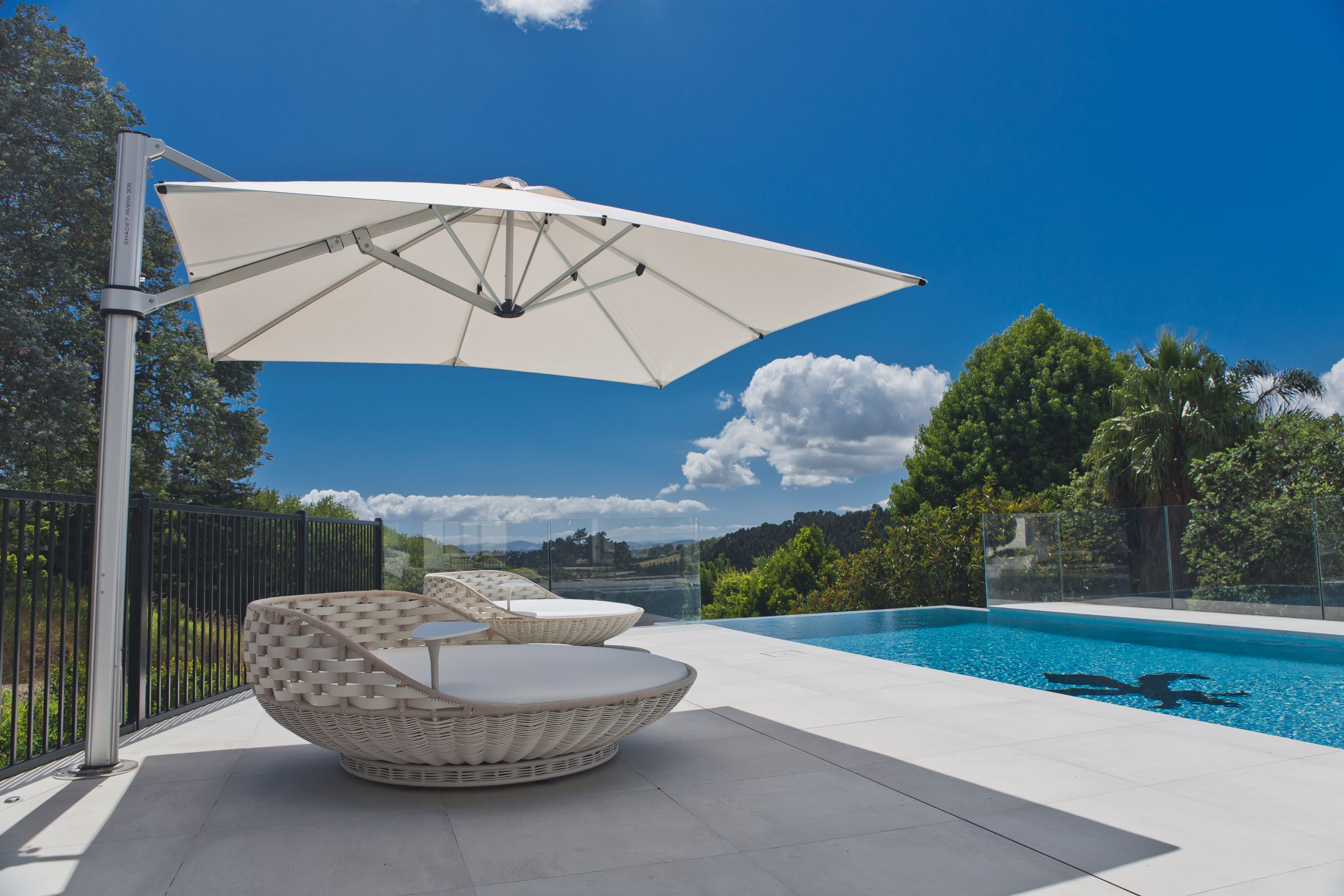 Outdoor cantilever umbrella over daybed